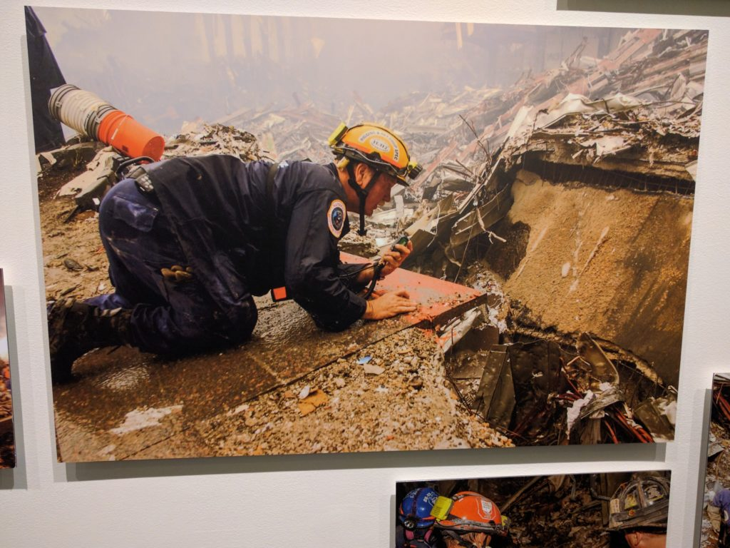 A rescue worker crawls through the rubble in the aftermath of 9/11. Photo by Andrea Booher.